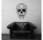 Cadre métallique moderne tête de mort dans un salon