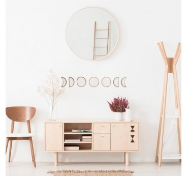 Lunar cycle wooden wall decoration in a boho style interior