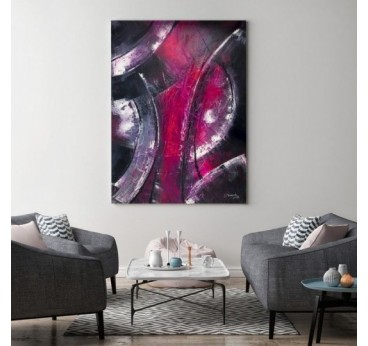 Pink abstract wall art in a design living room
