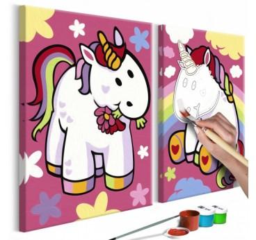 Tableau à peindre pour enfant de licornes sur fond rose avec des petits symboles pour la déco murale de chambre d'enfant