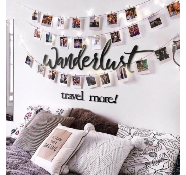 Wanderlust metal wall decoration in a bedroom for a unique interior
