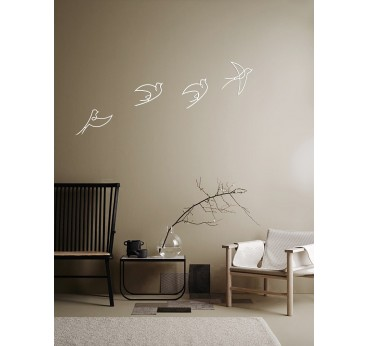 Design metallic decoration of white birds for a living room