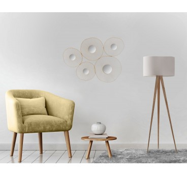 Modern metal wall decoration in round shape with golden colors in a contemporary living room