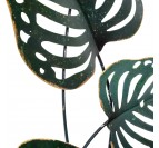 Metal wall decoration of monstera leaves for a trendy interior
