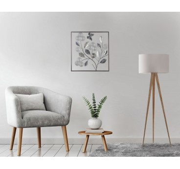 Metallic wall decoration of plant in its frame for a trendy and modern interior
