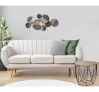 Round metal wall decoration with different colors in a design living room