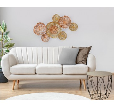 Metal wall decoration in a modern style of several coral circles in gold in a contemporary living room