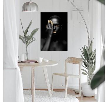 Tableau design d'une femme en noir et or pour créer un intérieur moderne et tendance