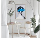 Design canvas of a woman with a trace of blue paint and a gold frame for your wall decoration