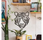 Metal wall decoration in a design way of a tiger head in a modern interior decoration