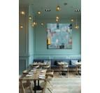 Tableau peinture design bleu dans une décoration murale moderne d'intérieur