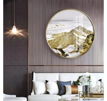 Round printed canvas of golden mountains with its frame in a modern interior