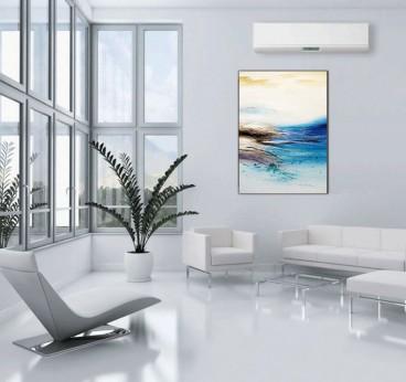 Tableau peinture moderne avec des couleurs bleues dans une décoration murale de salon