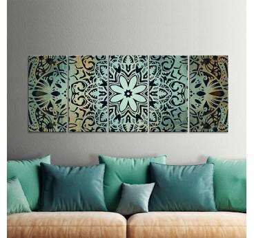 Tableau design de mandala vert en plusieurs panneaux dans une déco murale de salon