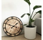 Modern wall clock in wood and metal to create an industrial wall decoration