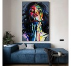 Painting by hand of a portrait of a woman in pop art version in a living room wall decoration