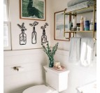 Toilets with our metallic wall decoration of vases with their flowers for a modern touch