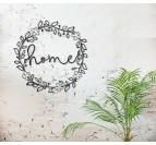 Metal wall decoration of flowers with the word home for a design interior
