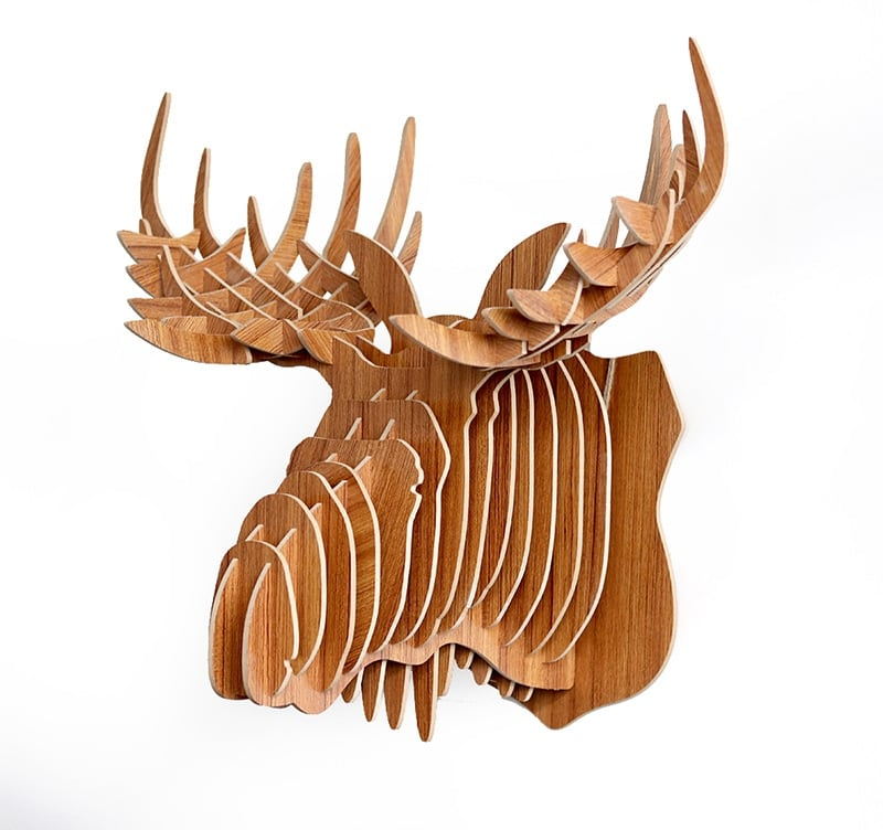 Modern wood wall decoration of an old elk for interior decoration