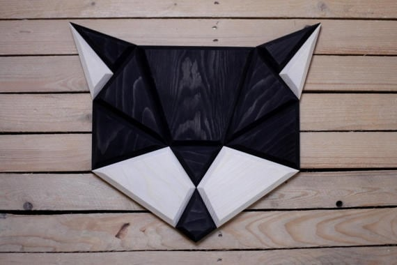 Wood wall decoration of a cat to create an animal design
