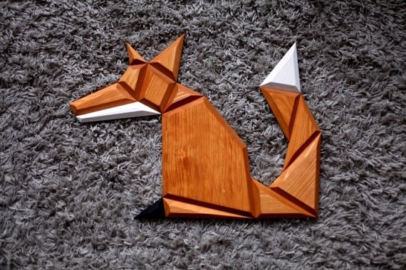 Wood modern wall decoration of an orange fox for a design interior