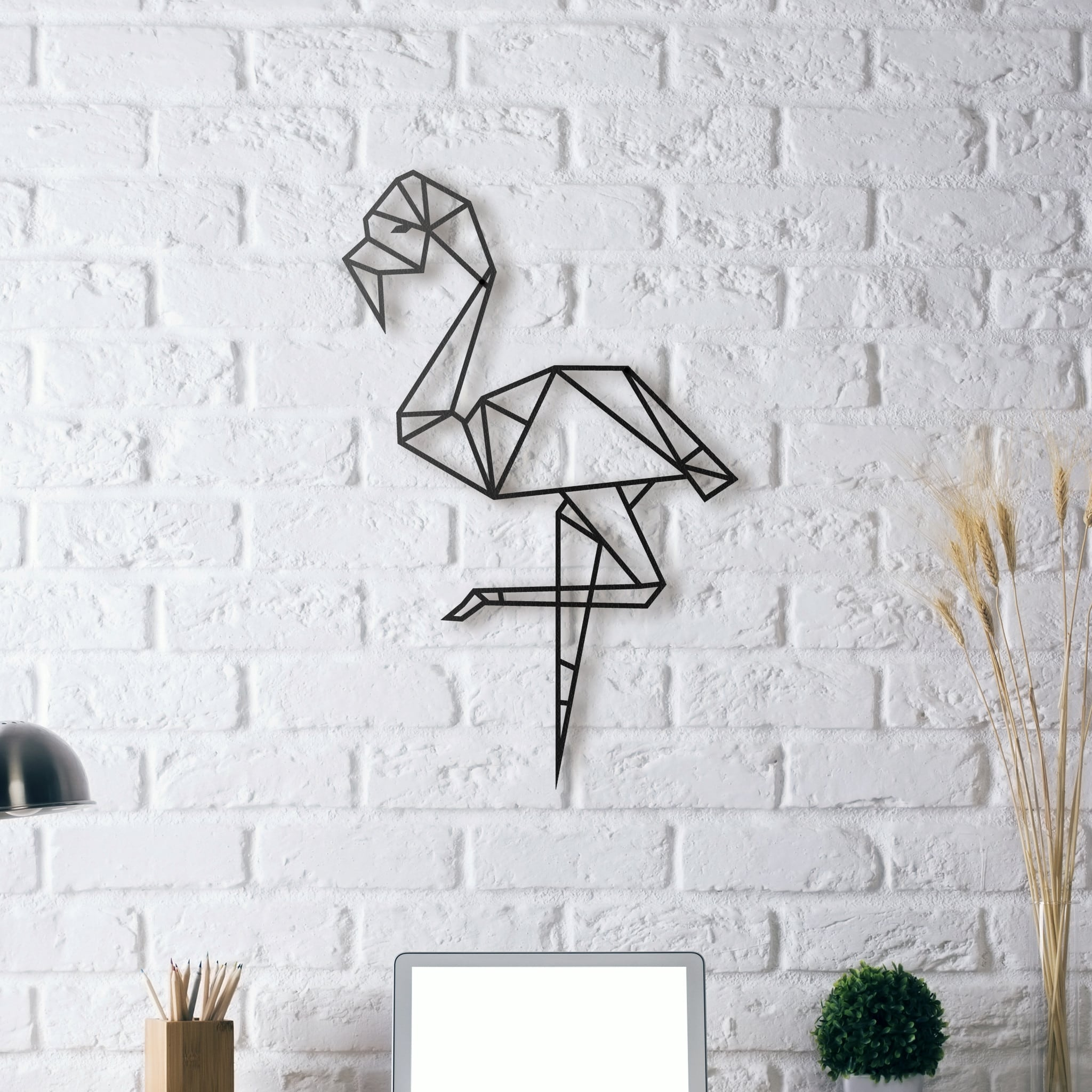 Wall metal decoration of a pink flamingo for a design interior