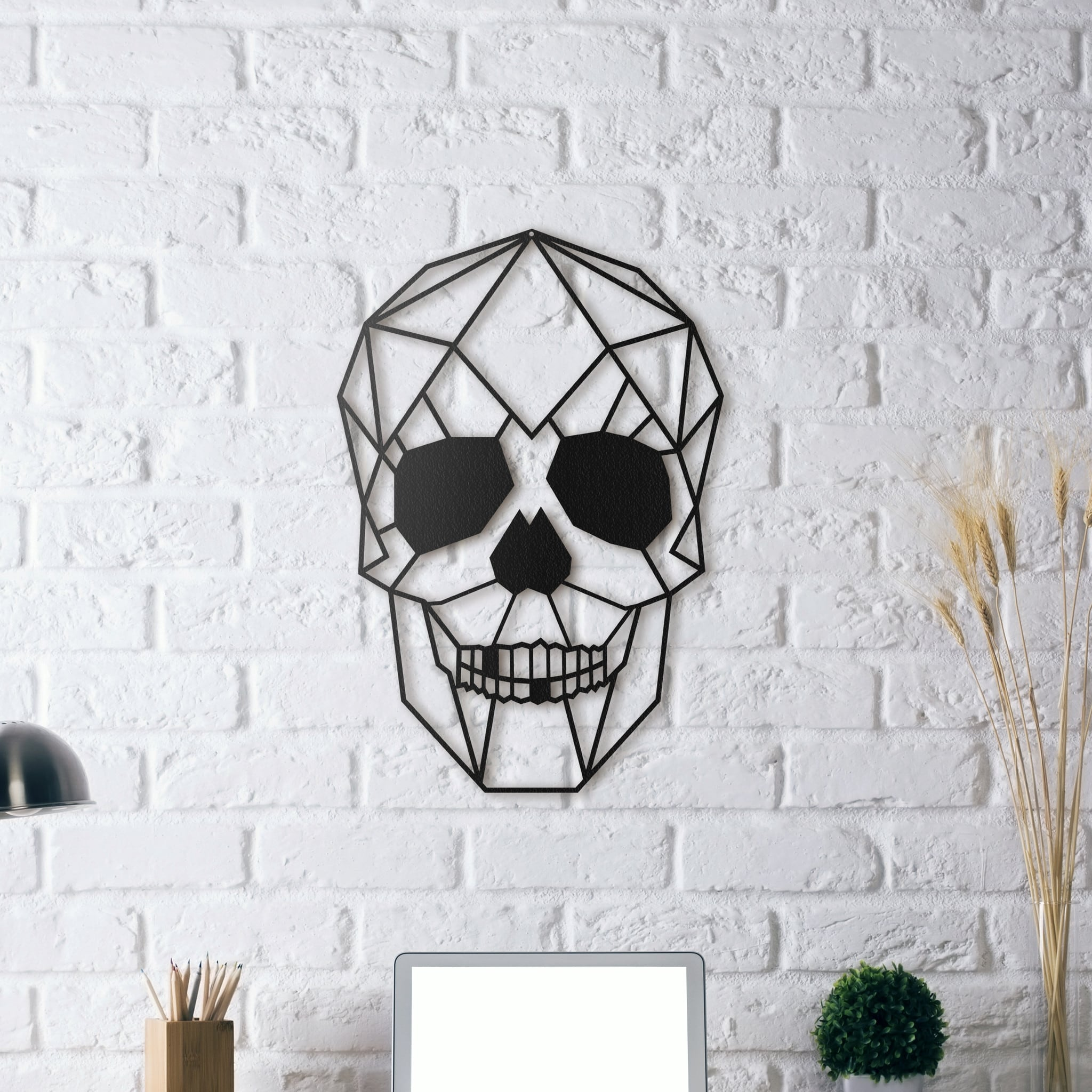 Design metal wall decoration of a skull for a modern interior