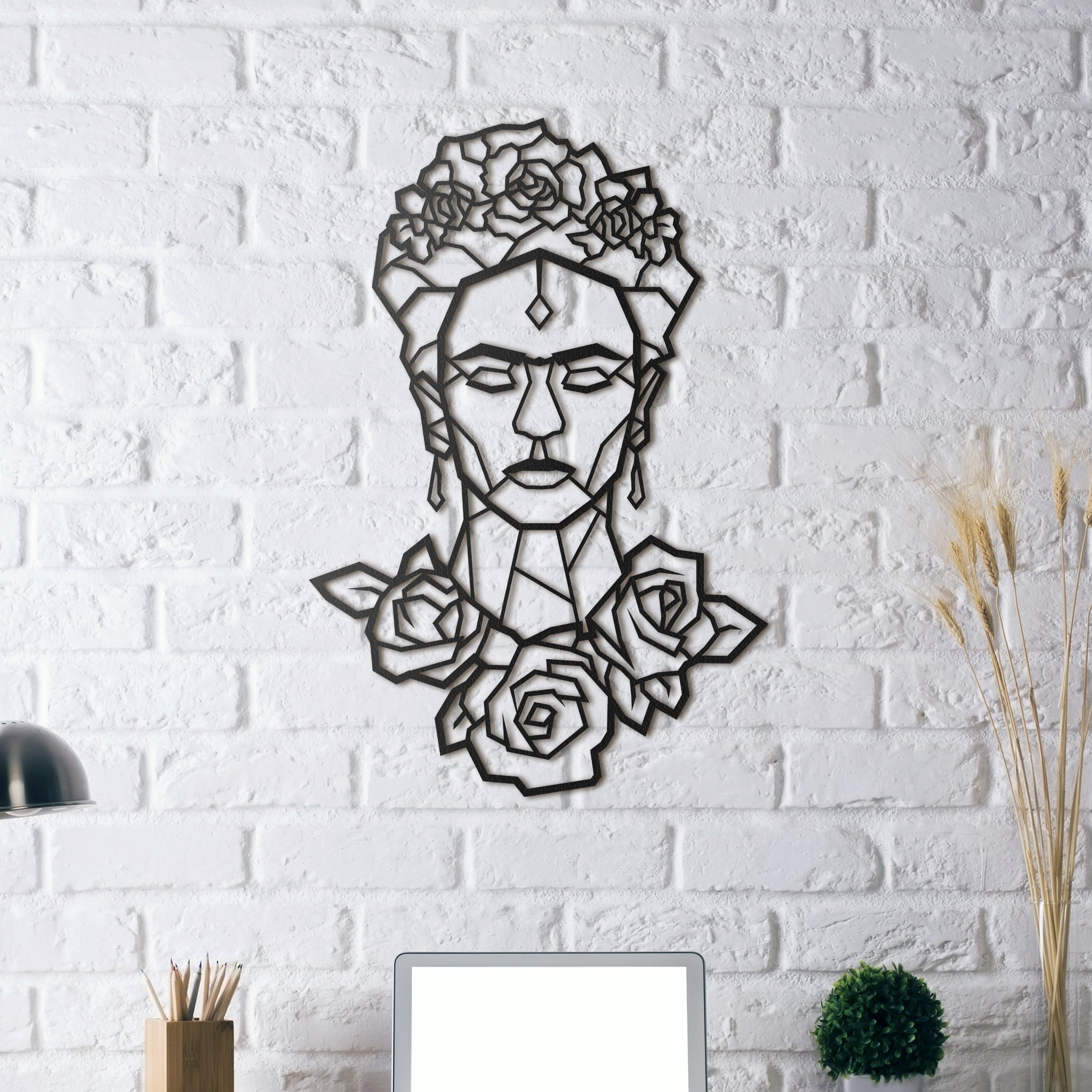 Design metal wall decoration of the artist Frida Kahlo for modern interior