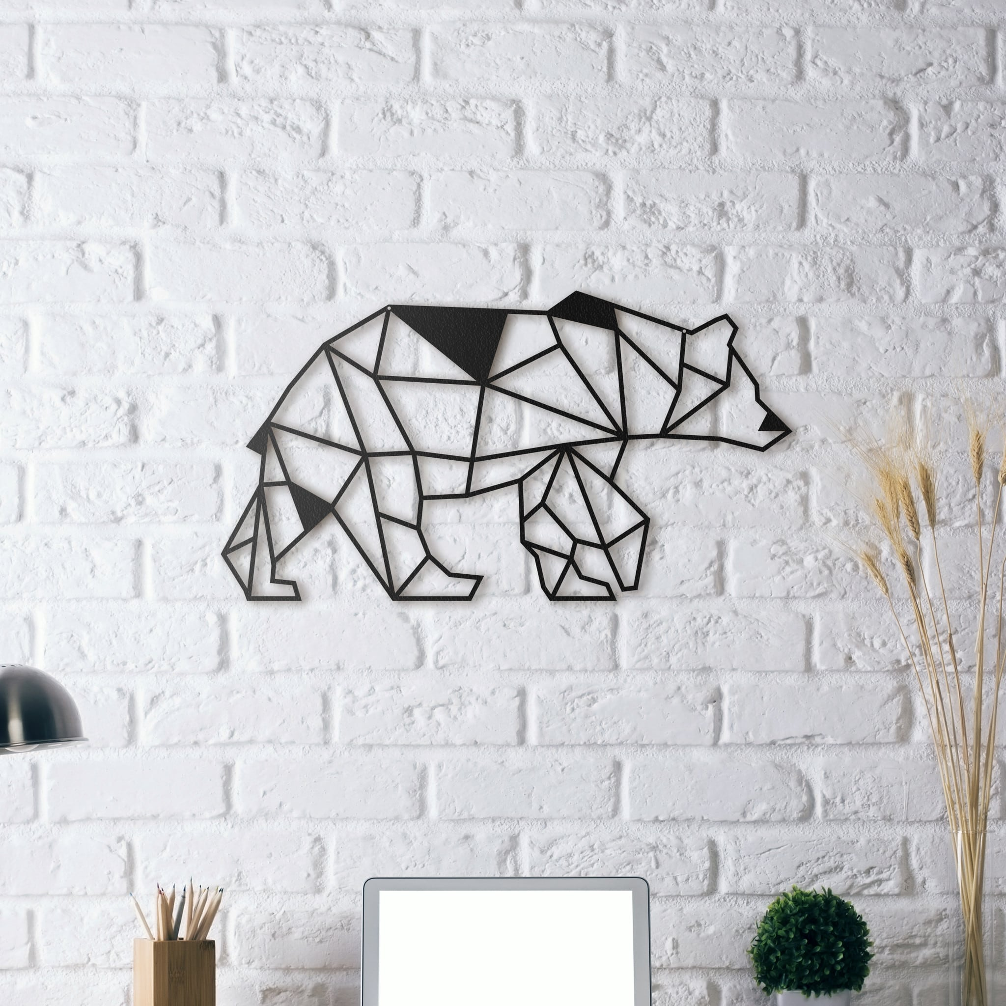 Design metal wall decoration of a bear to have a nature interior with a modern touch