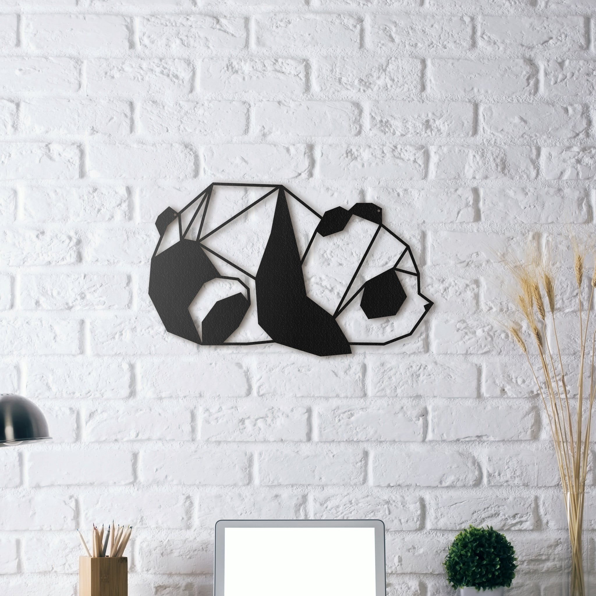 Metal wall decoration of a panda for a contemporary interior