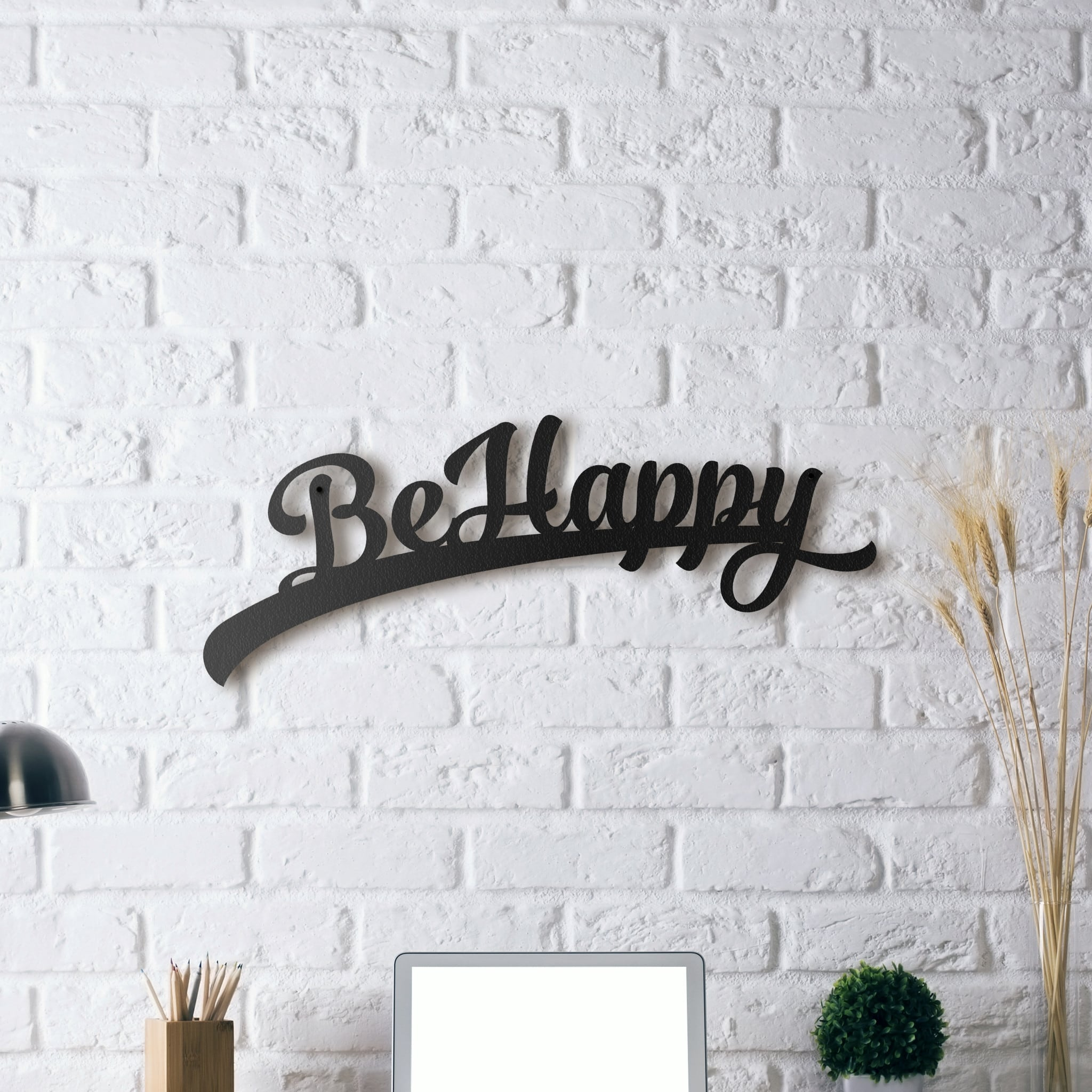 Zen metal decoration of the words be happy on metal for a cool interior
