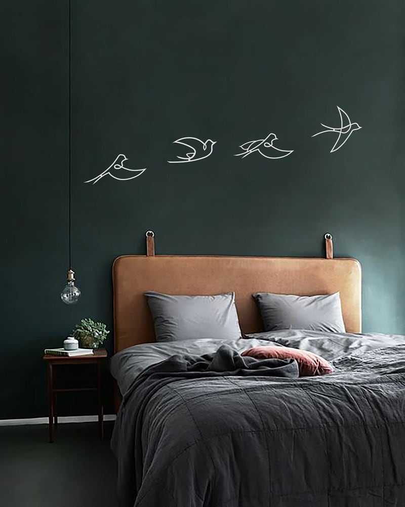 White metal decoration of birds with a design touch for wall interior