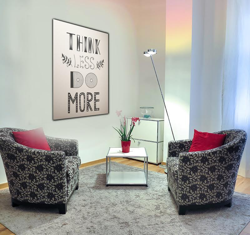 A modern printed canvas for all the business man with the mention think less do more to decorate you desk or your room decoration