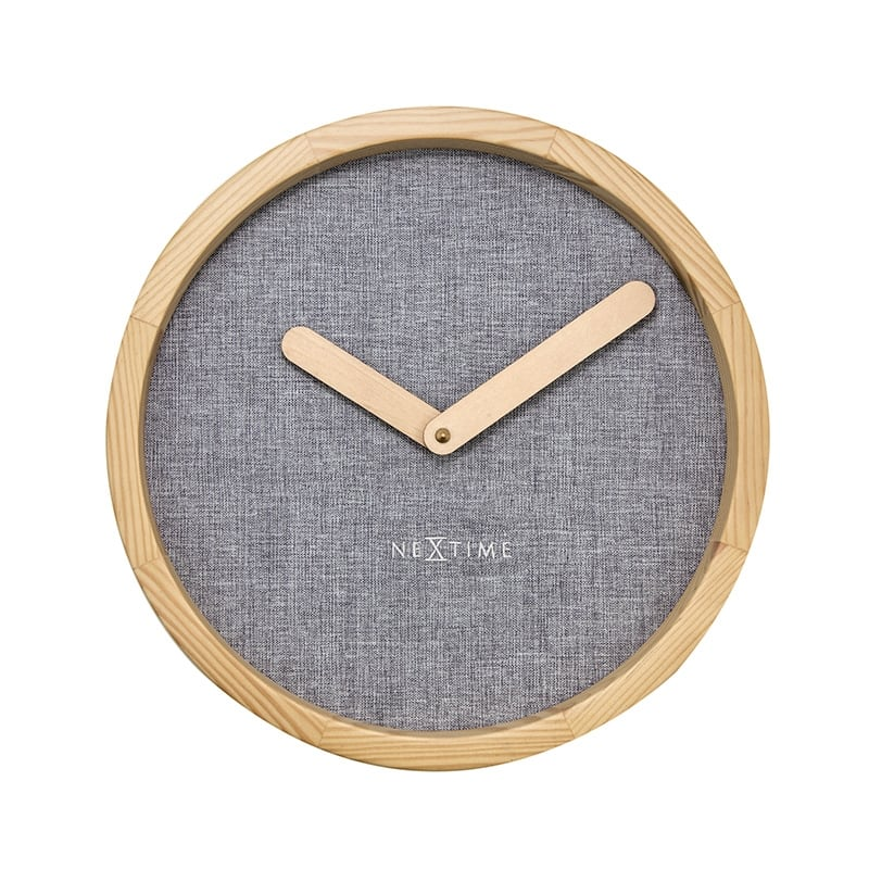 Modern wall clock made on grey cloth for design interior