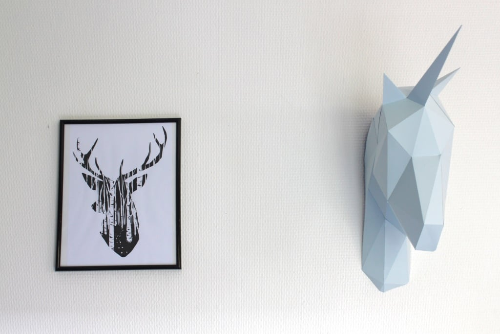 Paper wall trophy of an unicorn for a design and modern interior with different colors