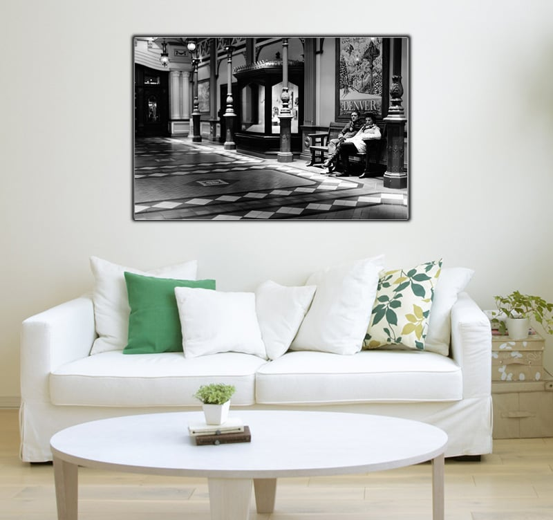 A couple and in room who are waiting on a modern art photo for your interior decoration