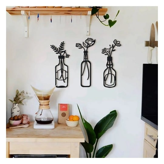 Metallic wall decoration of vases with flowers for a modern interior
