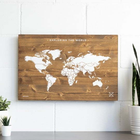 Wooden wall decoration of the world map in white for a modern interior