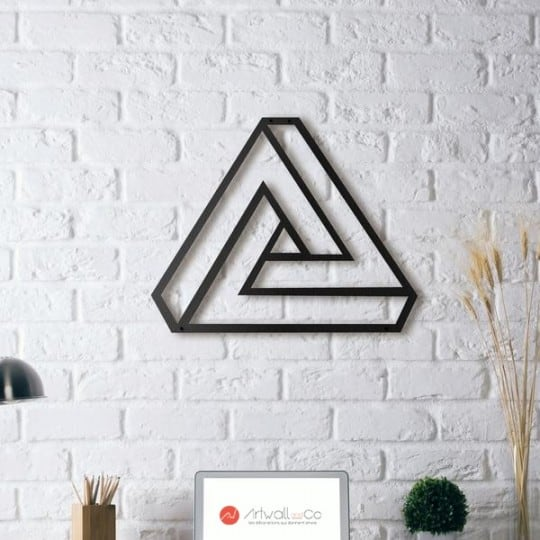 Metal wall decoration of an illusion triangle for modern interior