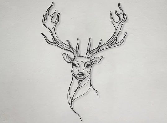 Eco-friendly wall decoration of a deer head for a nature interior
