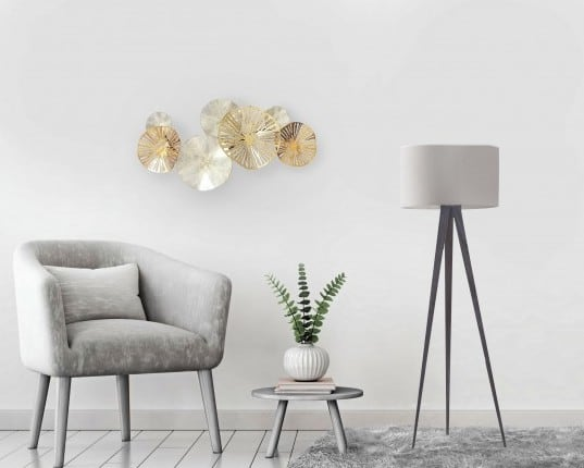 Modern metal wall decoration in gold and silver circles for a contemporary deco