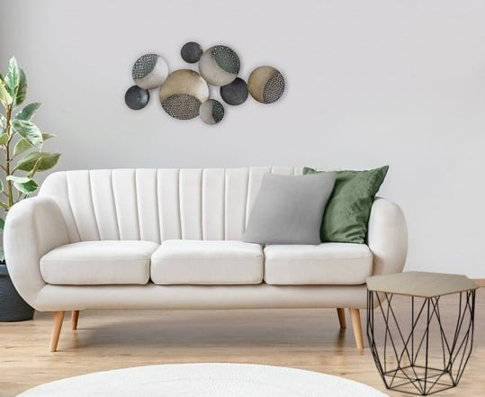 Grey metal wall decoration with a modern touch and different circles