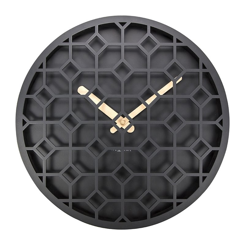 Modern discreet black wall clock for a design interior