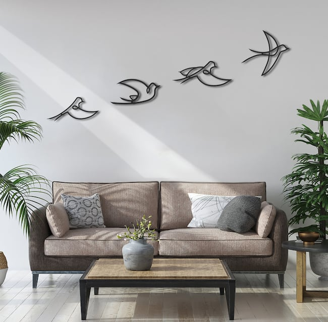 Flight metal wall decoration for a nature interior