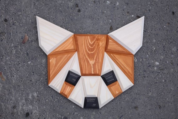 Wood wall decoration of a red panda for a design animal head decoration