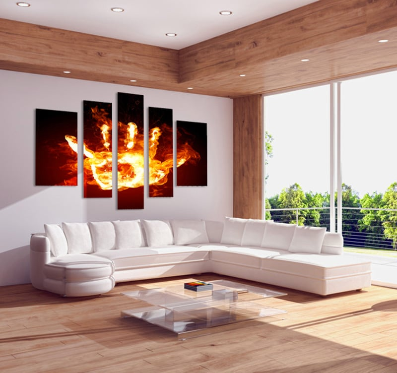 Multiple canvas of a fire hand with a black background to inspire your home with a touch of design