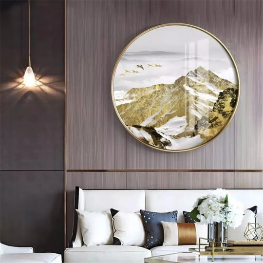 Tableau sur toile rond d'une montagne dorée avec son cadre