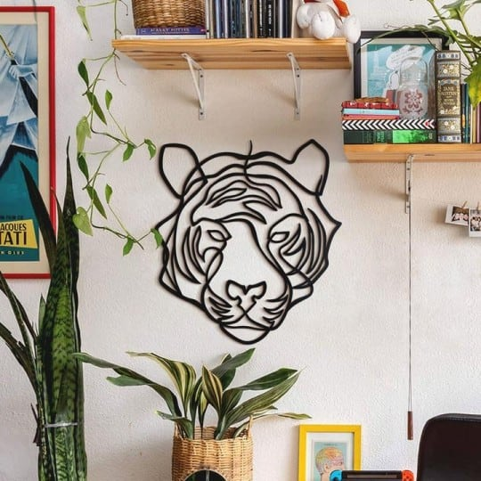 Metal wall decoration of a design tiger for a modern interior decoration
